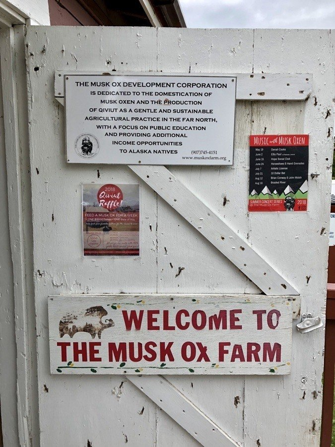 welcome to the musk ox farm sign.