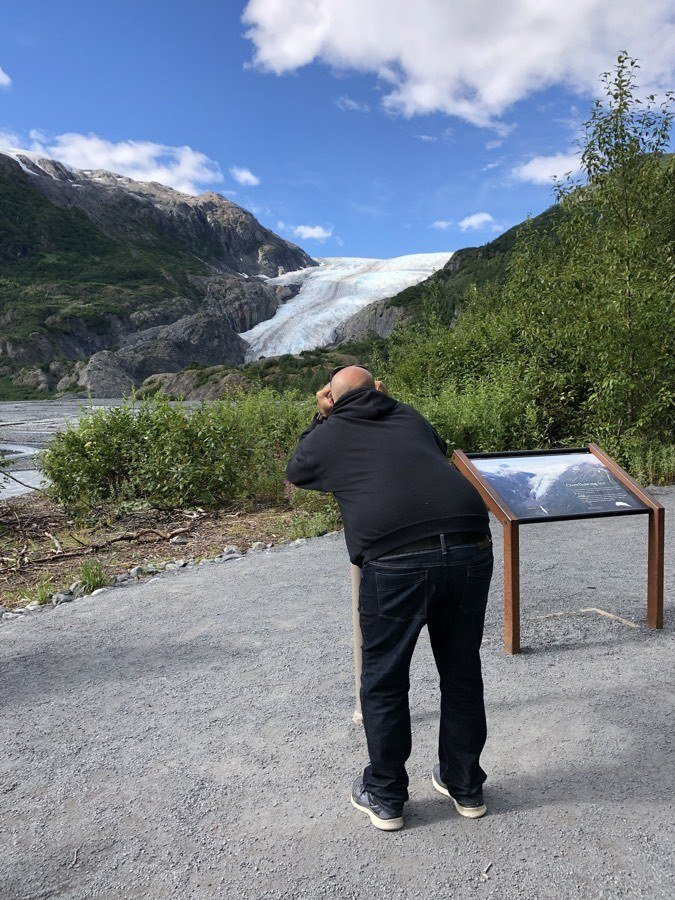 kevin looking at exit glacier through binoculars.